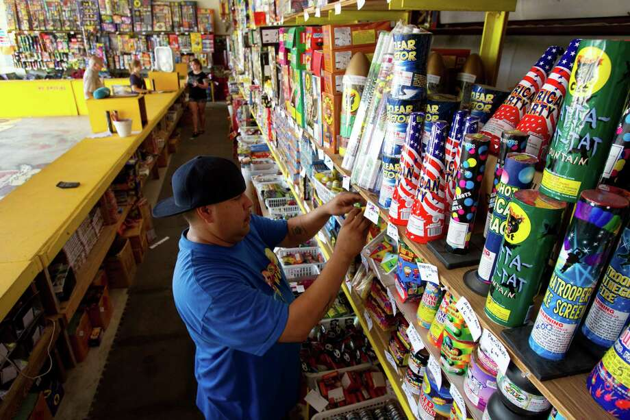 Lou Rodriguez stocks the shelves at Mrs. Becky's Firework Warehouse Wednesday, June 29, 2011, in Dickinson. If a state lawmaker has his way, fireworks could be sold more frequently in Texas.  Photo: Brett Coomer, Houston Chronicle / © 2011 Houston Chronicle