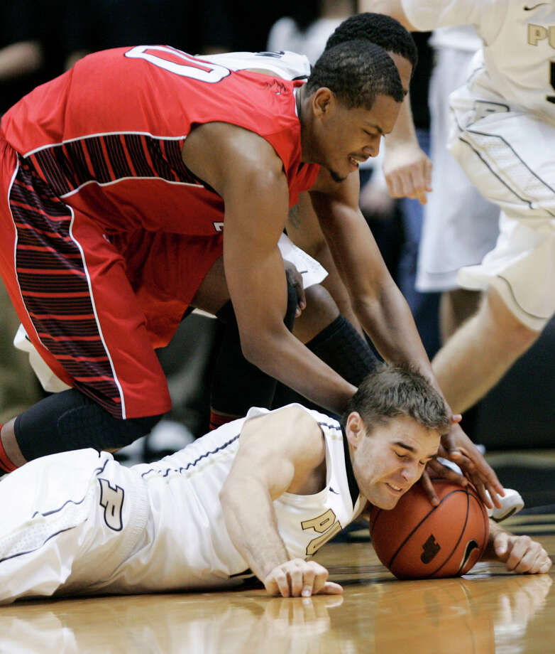 Prudue's Dru Anthrop, bottom, and Lamar's Rhon Mitchell reach for a loose ball during an NCAA basketball game Tuesday, Dec. 4, 2012, in West Lafayette, Ind. Purdue defeated Lamar 72-39. (AP Photo/Journal & Courier, John Terhune) NO SALES Photo: John Terhune, MBO / Journal & Courier