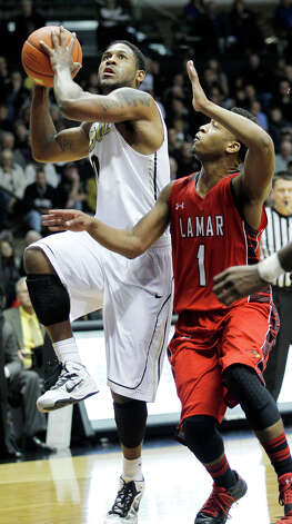 Purdue's Terone Johnson drives to the basket against Lamar's Keilan Blanks during an NCAA college basketball game Tuesday, Dec. 4, 2012, in West Lafayette, Ind. Purdue defeated Lamar 72-39. (AP Photo/Journal & Courier, John Terhune)  NO SALES Photo: John Terhune, MBO / Journal & Courier