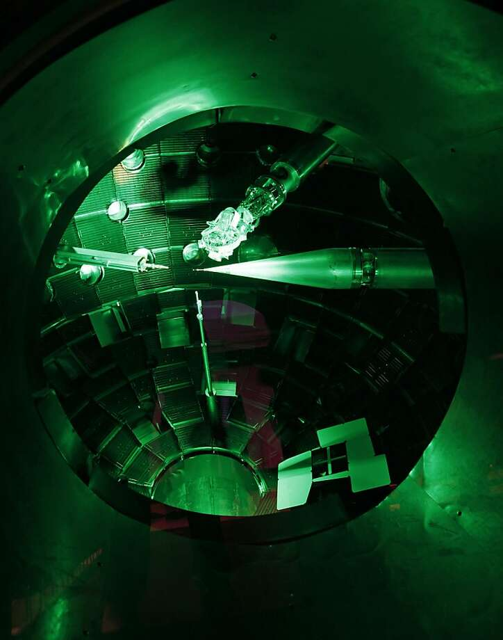 Inside the target chamber of the National Ignition Facility, shown in May 2009 at its dedication, a small gold container the size of a pencil eraser is the focus of 192 laser beams. Photo: Michael Macor, The Chronicle