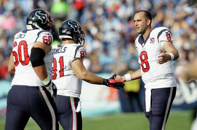Houston Texans quarterback Matt Schaub (8) congratulates Owen Daniels (81) and Ben Jones (60) after a play against the Tennessee Titans in the first quarter of an NFL football game on Sunday, Dec. 2, 2012, in Nashville, Tenn. (AP Photo/Wade Payne) Photo: Wade Payne, Associated Press / FR23601 AP