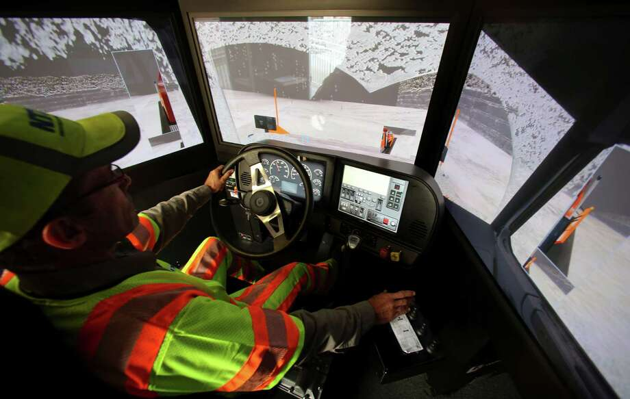 Driver Terence Mundt operates a snowplow simulator during a North Texas Tollway Authority training class in Plano last month. The simulator helps snowplow operators not used to ice and snow on a regular basis. Photo: LM Otero, STF / AP
