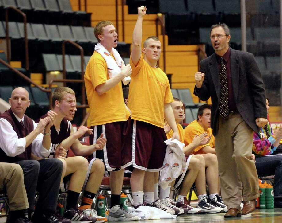 HANS PENNINK / SPECIAL TO THE TIMES UNION- Burnt Hills-Ballston Lake  Head Coach George Dudas coaches his team against Lansingburgh during their section II Class A boys high school basketball title game at the Glens Falls Civic Center in Glens Falls, N.Y., Sunday, March 7, 2010  High School Sports Photo: Hans Pennink / 00007776A