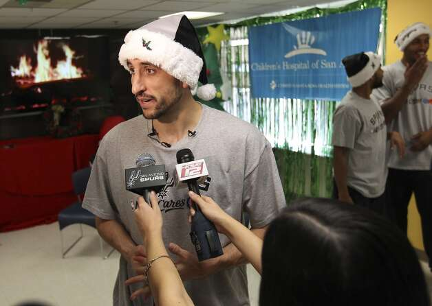 Spurs guard Manu Ginobili talks to the media after he and teammates Boris Diaw and Patty Mills took photos with young patients at the Children's Hospital of San Antonio on Tuesday, Dec. 4, 2012. (Kin Man Hui / San Antonio Express-News)