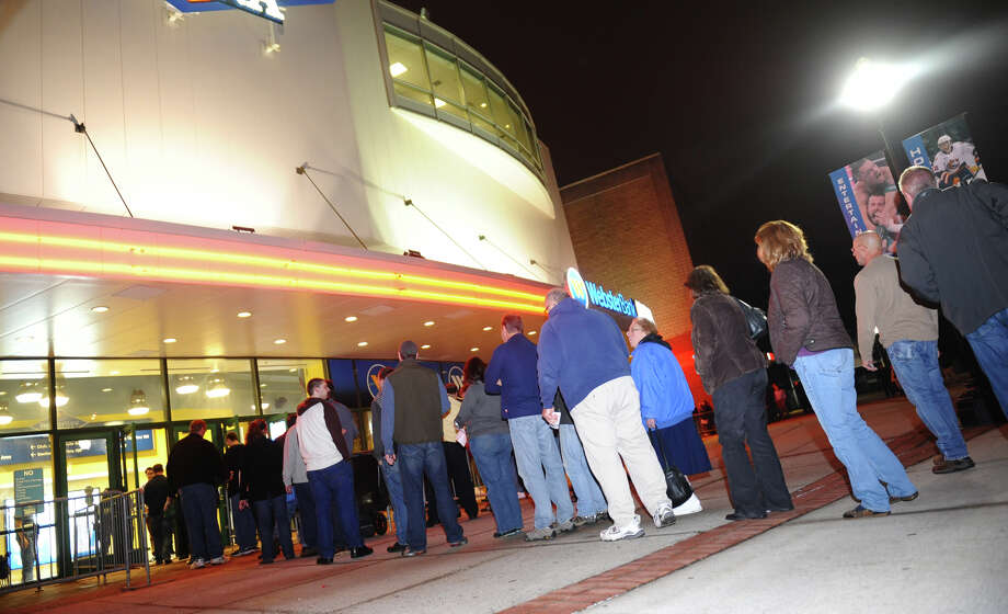 Long lines form at the Webster Bank Arena to see Patti Smith and Neil Young in concert in Bridgeport, Conn. on Tuesday December 4, 2012. Photo: Christian Abraham / Connecticut Post