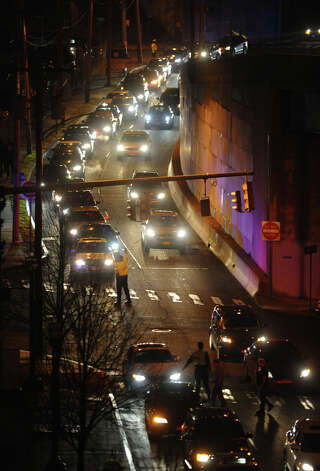 Long lines of traffic form at the Webster Bank Arena to see Patti Smith and Neil Young in concert in Bridgeport, Conn. on Tuesday December 4, 2012. Photo: Christian Abraham / Connecticut Post