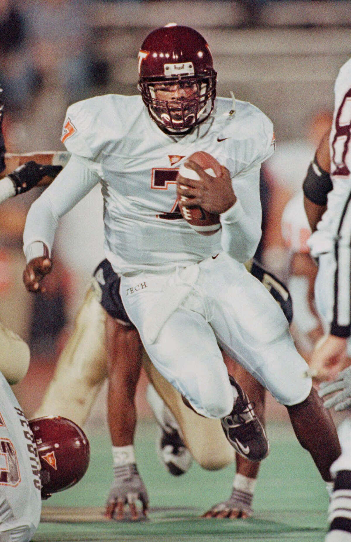 MICHAEL VICK, 1999 School, position: Virginia Tech, QB Heisman finish: Third Heisman winner: Ron Dayne, Wisconsin RB Why he was considered: Despite Dayne's runaway Heisman victory - he had more than 1,000 votes over second-place Joe Hamilton of Georgia Tech - Vick gave the country a taste of his highlight-reel talent, guiding the Hokies to a BCS title-game loss to Florida State. Why he didn't win: Dayne finished a decorated career by smashing Ricky Williams' NCAA career-rushing mark with 6,397 yards and leading the Badgers to the Rose Bowl.