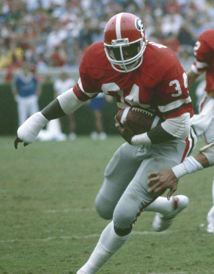 HERSCHEL WALKER, 1980 School, position: Georgia, RB Heisman finish: Third Heisman winner: George Rogers, South Carolina RB Why he was considered: Walker, who finished second in the Heisman voting as a sophomore and won it as a junior, set a then-freshman rushing record with 1,616 yards and led the Bulldogs to the national championship.  Why he didn't win: Rogers led the nation in rushing with 1,781 yards. Photo: Associated Press / 1982 AP