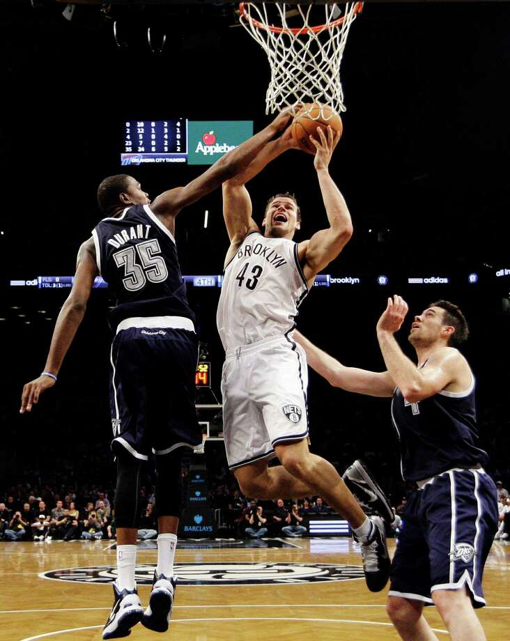 Oklahoma City Thunder forward Kevin Durant (35) defends as Brooklyn Nets forward Kris Humphries (43) goes up for a layup in the second half of their NBA basketball game at Barclays Center, Tuesday, Dec. 4, 2012, in New York. The Thunder won 117-111. (AP Photo/Kathy Willens) Photo: Kathy Willens