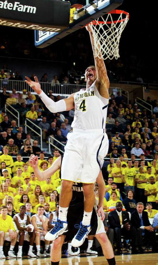 Michigan forward Mitch McGary (4) shoots in the second half of an NCAA college basketball game against Western Michigan, Tuesday, Dec. 4, 2012, at Crisler Center in Ann Arbor, Mich. Michigan won 73-41. (AP Photo/Tony Ding) Photo: Tony Ding