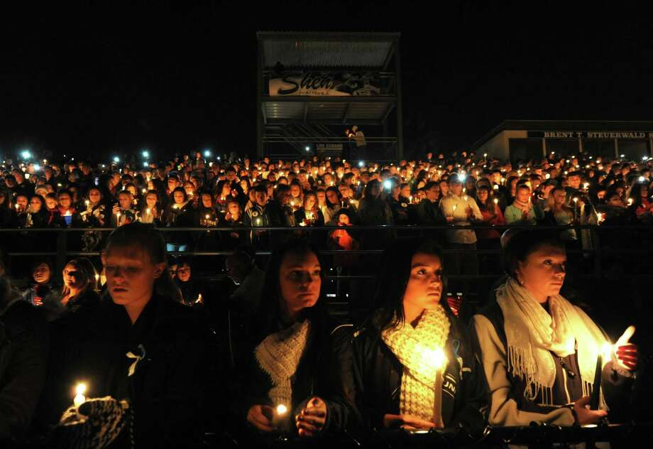 Thousands join in a candlelight vigil and memorial service for the Shen crash victims at Shenendehowa High School in Clifton Park, NY Tuesday Dec. 4, 2012. Shen students Chris Stewart and Deanna Rivers died in the crash with Matt Hardy and Bailey Wind being seriously injured.(Michael P. Farrell/Times Union) Photo: Michael P. Farrell