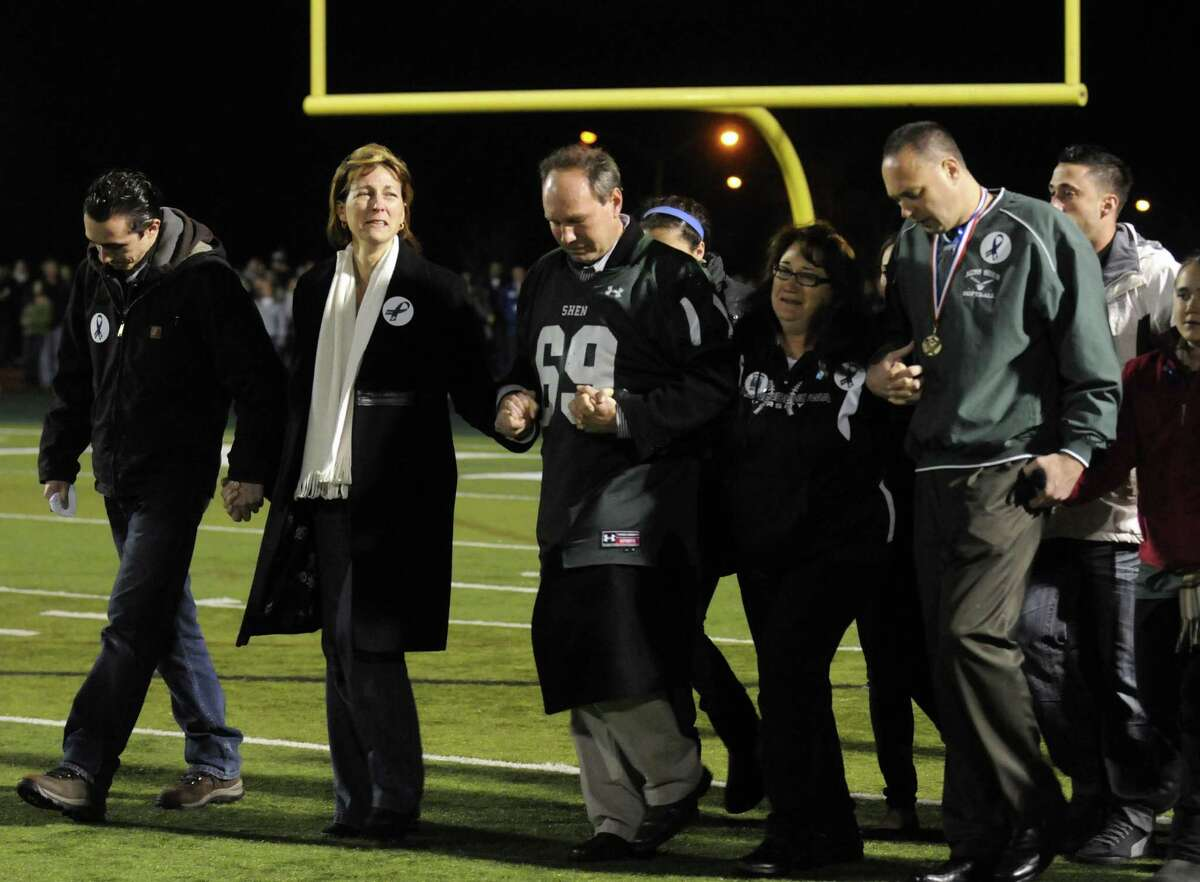 The families of crash victims Chris Stewart and Deanna Rivers attend a candlelight vigil and memorial service for the Shen crash victims at Shenendehowa High School in Clifton Park, NY Tuesday Dec. 4, 2012. Shen students Chris Stewart and Deanna Rivers died in the crash with Matt Hardy and Bailey Wind being seriously injured.(Michael P. Farrell/Times Union)