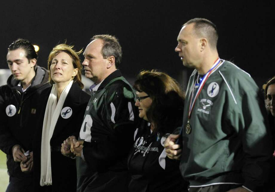The families of crash victims Chris Stewart and Deanna Rivers attend a candlelight vigil and memorial service for the Shen crash victims at Shenendehowa High School in Clifton Park, NY Tuesday Dec. 4, 2012. Shen students Chris Stewart and Deanna Rivers died in the crash with Matt Hardy and Bailey Wind being seriously injured.(Michael P. Farrell/Times Union) Photo: Michael P. Farrell