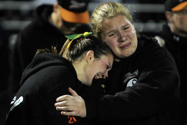 Members of the Capital District Crossfire girls softball team River Ward, left, and Hannah Sears teammates of Deanna Rivers join thousands during a candlelight vigil and memorial service for the Shen crash victims at Shenendehowa High School in Clifton Park, NY Tuesday Dec. 4, 2012. Shen students Chris Stewart and Deanna Rivers died in the crash with  Matt Hardy and Bailey Wind being seriously injured.(Michael P. Farrell/Times Union) Photo: Michael P. Farrell