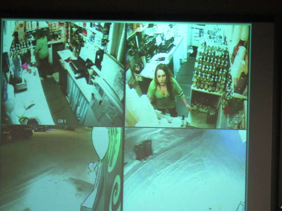 During a news conference, police show surveillance video of  Samantha Koenig, 18, making a cup of Americano coffee for a customer who shortly after abducted her Feb. 1, 2012, in Anchorage, Alaska. Police on Tuesday, Dec. 4, 2012, released the surveillance camera footage from the February abduction at the Common Grounds expresso stand in Anchorage. The release came two days after her confessed killer, Israel Keyes, was found dead in his Anchorage jail cell, apparently by suicide. (AP Photo/Mark Thiessen) Photo: Mark Thiessen