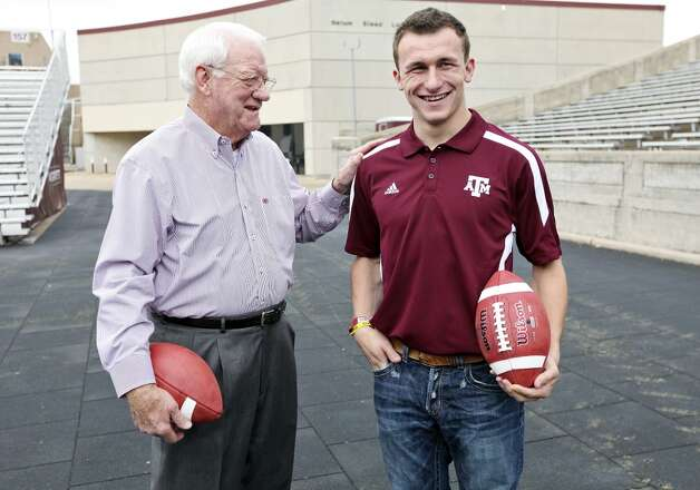 Former Texas A&M running back John David Crow, who won the 1957 Heisman Trophy, and current Texas A&M freshman quarterback Johnny Manziel, who is a Heisman finalist, talk before a portrait session Tuesday, Dec. 4, 2012, at Kyle Field in College Station.