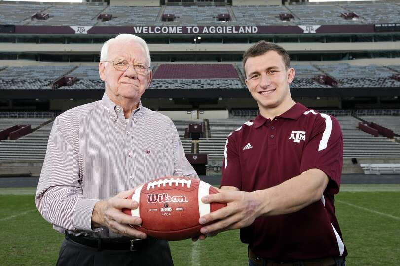 Former Texas A&M running back John David Crow, who won the 1957 Heisman Trophy, poses with current T