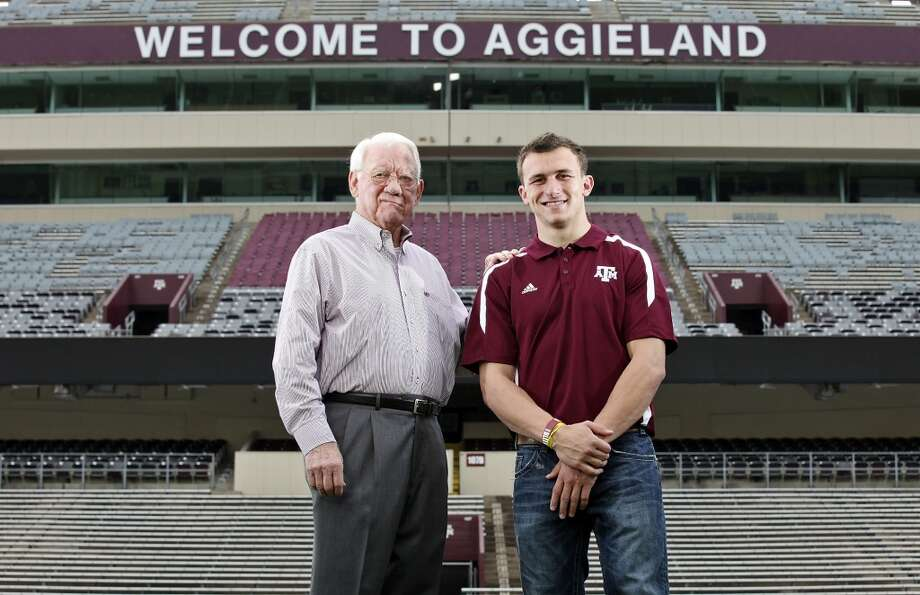 Former Texas A&M running back John David Crow, who won the 1957 Heisman Trophy, poses with current Texas A&M freshman quarterback Johnny Manziel, who is a Heisman finalist, Tuesday, Dec. 4, 2012, at Kyle Field in College Station.
