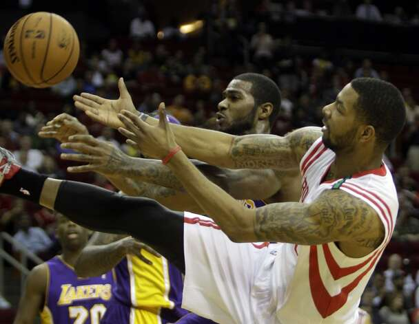Dec. 4: Rockets 107, Lakers 105Toney Douglas and Marcus Morris of the Rockets fight for possession against the Lakers. (Melissa Phillip / Houston Chronicle)