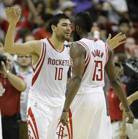 Rockets forward Carlos Delfino celebrates the win by embracing guard James Harden. (Melissa Phillip / Houston Chronicle)