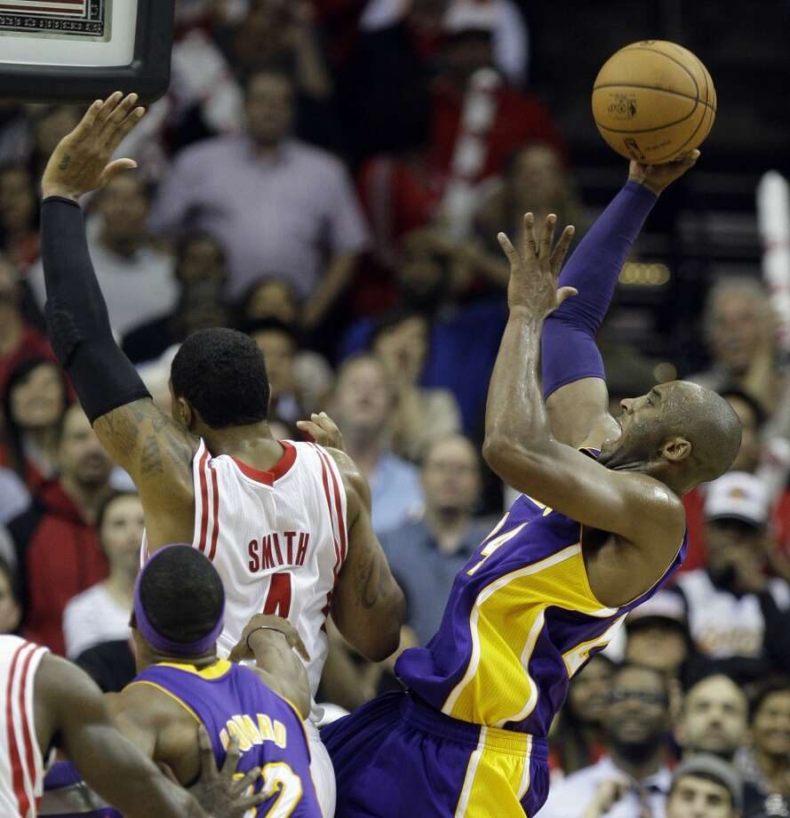 Lakers guard Kobe Bryant attempts a shot over Greg Smith of the Rockets. (Melissa Phillip / Houston Chronicle)