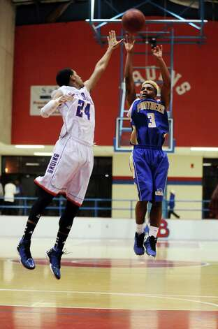 Ozen Panther Jakobi Jones, #3, puts the ball up for two points during the West Brook high school basketball game against the Ozen  on Tuesday December 4, 2012, at West Brook High School. West Brook won over Ozen 52 - 46. Photo taken: Randy Edwards/The Enterprise Photo: Randy Edwards