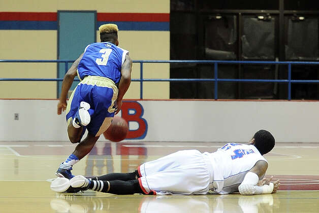 Ozen Panther Jakobi Jones, #3, fights the ball away from Jordan Green, #24, and storms down the court during the West Brook high school basketball game against the Ozen  on Tuesday December 4, 2012, at West Brook High School. West Brook won over Ozen 52 - 46. Photo taken: Randy Edwards/The Enterprise Photo: Randy Edwards