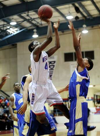 West Brook Bruin Jjuan Hadnot, #42, puts the ball up for two points during the West Brook high school basketball game against the Ozen  on Tuesday December 4, 2012, at West Brook High School. West Brook won over Ozen 52 - 46. Photo taken: Randy Edwards/The Enterprise Photo: Randy Edwards