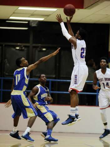 West Brook Bruin Khyee Randall, #23, sinks tthe bal for two points during the West Brook high school basketball game against the Ozen  on Tuesday December 4, 2012, at West Brook High School. West Brook won over Ozen 52 - 46. Photo taken: Randy Edwards/The Enterprise Photo: Randy Edwards