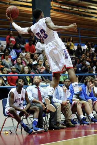 West Brook Bruin Khyce Randall, #23, saves the ball from going out of bounds during the West Brook high school basketball game against the Ozen  on Tuesday December 4, 2012, at West Brook High School. West Brook won over Ozen 52 - 46. Photo taken: Randy Edwards/The Enterprise
