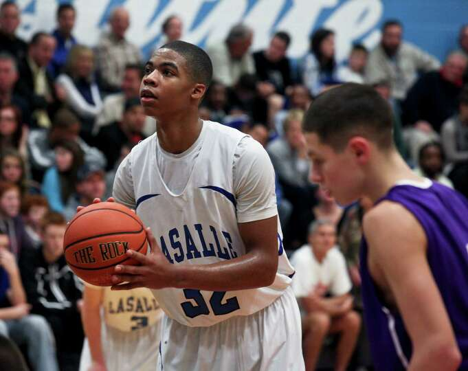 Elijah Burns, of La Salle Institute, lines up a free throw at a Troy High School vs. La Salle Instit
