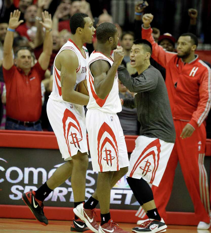 With huge contributions from Greg Smith, left, and Toney Douglas off the bench, Jeremy Lin, right, and the rest of the Rockets celebrated an improbable comeback victory against the Lakers. Photo: Melissa Phillip, Staff / © 2012 Houston Chronicle