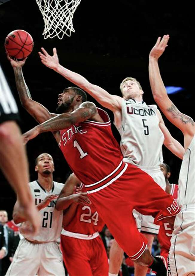 North Carolina State's Richard Howell (1) drives past Connecticut's Niels Giffey (5) during the second half of their NCAA college basketball game in the Jimmy V Classic at Madison Square Garden, Tuesday, Dec. 4, 2012, in New York. North Carolina State won 69-65. (AP Photo/Frank Franklin II)