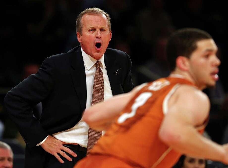 Head coach Rick Barnes of the Texas Longhorns directs his team in the first half against the Georgetown Hoyas during the Jimmy V Classic on December 4, 2012 at Madison Square Garden in New York City. Photo: Elsa, Getty Images / 2012 Getty Images