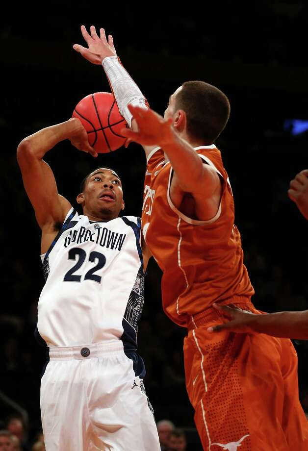 Otto Porter #22 of the Georgetown Hoyas takes a shot as Ioannis Papapetrou #33 of the Texas Longhorns defends during the Jimmy V Classic on December 4, 2012 at Madison Square Garden in New York City. Photo: Elsa, Getty Images / 2012 Getty Images