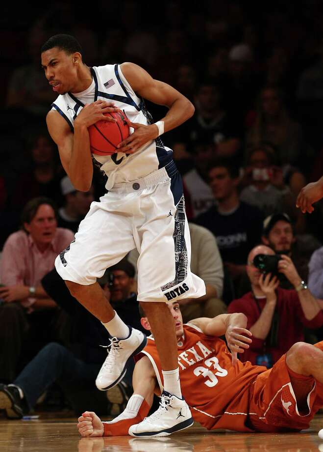 Otto Porter #22 of the Georgetown Hoyas grabs the ball from Ioannis Papapetrou #33 of the Texas Longhorns during the Jimmy V Classic on December 4, 2012 at Madison Square Garden in New York City. The Georgetown Hoyas defeated the Texas Longhorns 64-41. Photo: Elsa, Getty Images / 2012 Getty Images