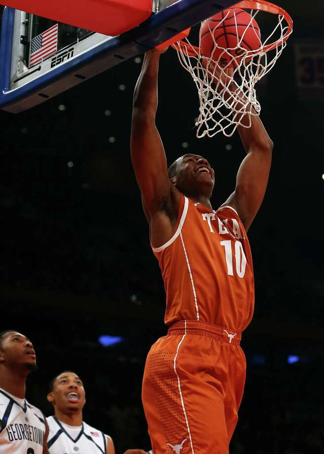 Jonathan Holmes #10 of the Texas Longhorns dunks the ball in the second half against the Georgetown Hoyas during the Jimmy V Classic on December 4, 2012 at Madison Square Garden in New York City. The Georgetown Hoyas defeated the Texas Longhorns 64-41. Photo: Elsa, Getty Images / 2012 Getty Images