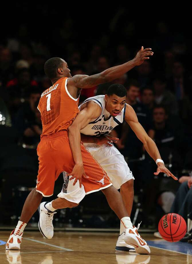 Otto Porter #22 of the Georgetown Hoyas tries to get around Sheldon McClellan #1 of the Texas Longhorns during the Jimmy V Classic on December 4, 2012 at Madison Square Garden in New York City. The Georgetown Hoyas defeated the Texas Longhorns 64-41. Photo: Elsa, Getty Images / 2012 Getty Images
