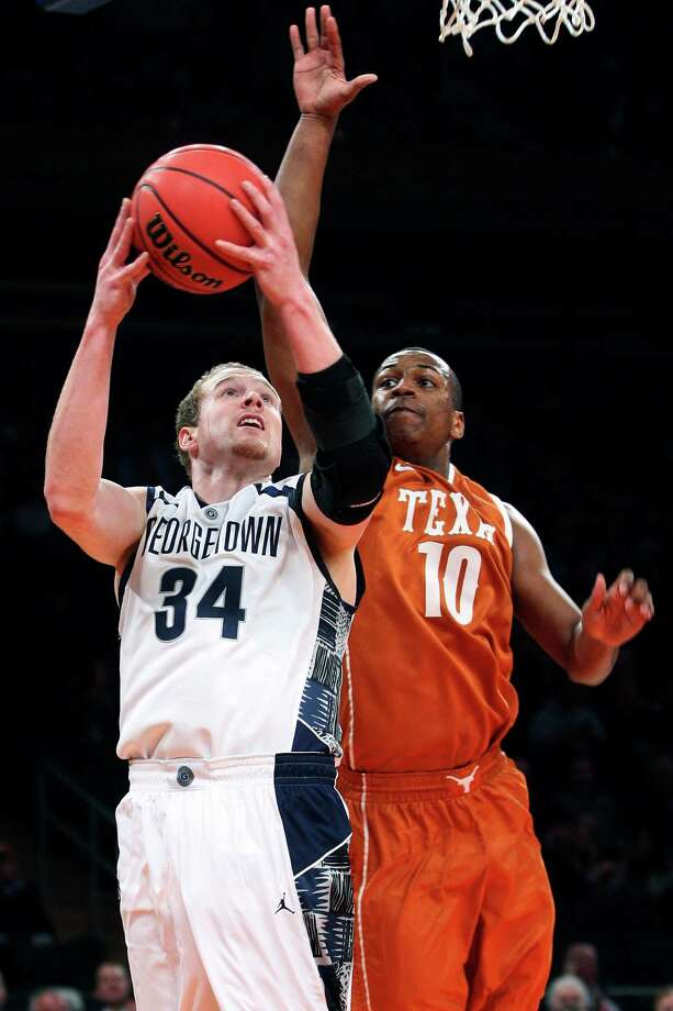 Georgetown's Nate Lubick (34) drives past Texas' Jonathan Holmes (10) during the first half of their NCAA college basketball game in the Jimmy V Classic, Tuesday, Dec. 4, 2012, at Madison Square Garden in New York. Photo: Frank Franklin II, Associated Press / AP