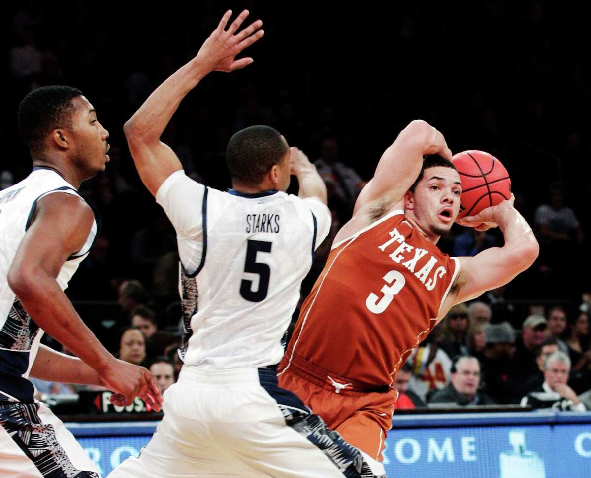 Texas' Javan Felix (3) looks to pass away from Georgetown's Markel Starks (5) during the second half of their NCAA college basketball game in the Jimmy V Classic at Madison Square Garden, Tuesday, Dec. 4, 2012, in New York. Georgetown won 64-41.