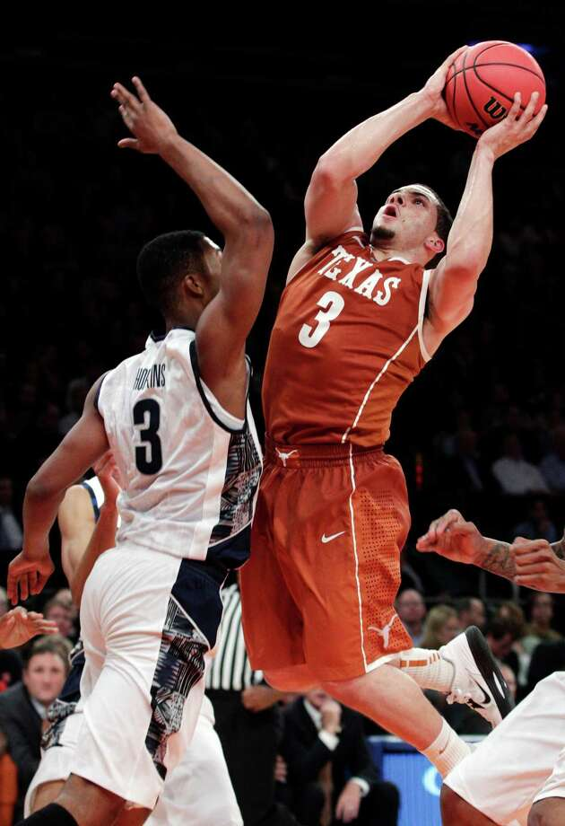 Texas' Javan Felix (3) shoots over Georgetown's Mikael Hopkins (3) during the second half of their NCAA college basketball game in the Jimmy V Classic at Madison Square Garden, Tuesday, Dec. 4, 2012, in New York. Georgetown won 64-41. Photo: Frank Franklin II, Associated Press / AP