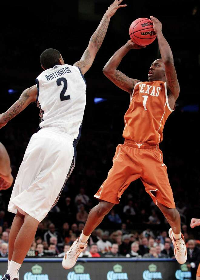 Texas' Sheldon McClellan (1) shoots over Georgetown's Greg Whittington (2) during the second half of their NCAA college basketball game in the Jimmy V Classic at Madison Square Garden, Tuesday, Dec. 4, 2012, in New York. Georgetown won 64-41. Photo: Frank Franklin II, Associated Press / AP