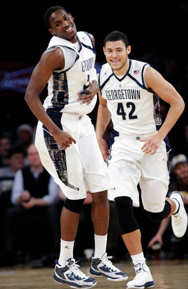 Georgetown's Aaron Bowen (23) and Bradley Hayes (42) celebrate a score during the second half of their NCAA college basketball game against Texas in the Jimmy V Classic at Madison Square Garden, Tuesday, Dec. 4, 2012, in New York. Georgetown won 64-41. Photo: Frank Franklin II, Associated Press / AP