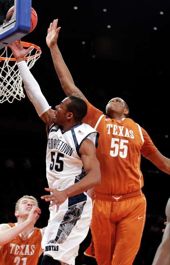 Georgetown's Jabril Trawick (55) drives past Texas' Cameron Ridley, right, during the first half of their NCAA college basketball game in the Jimmy V Classic, Tuesday, Dec. 4, 2012, at Madison Square Garden in New York. Photo: Frank Franklin II, Associated Press / AP