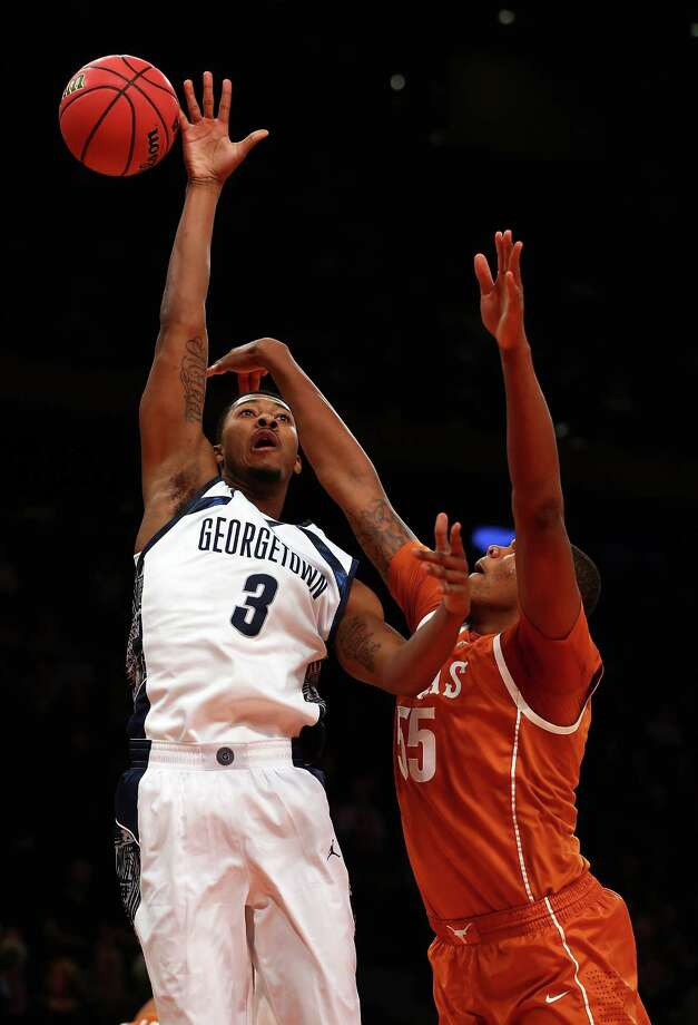 Mikael Hopkins #3 of the Georgetown Hoyas tries to shoot as Cameron Ridley #55 of the Texas Longhorns knocks the ball away in the first half during the Jimmy V Classic on December 4, 2012 at Madison Square Garden in New York City. Photo: Elsa, Getty Images / 2012 Getty Images
