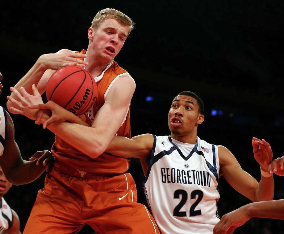 Connor Lammert #21 of the Texas Longhorns grabs the rebound before Otto Porter #22 of the Georgetown Hoyas during the Jimmy V Classic on December 4, 2012 at Madison Square Garden in New York City. Photo: Elsa, Getty Images / 2012 Getty Images