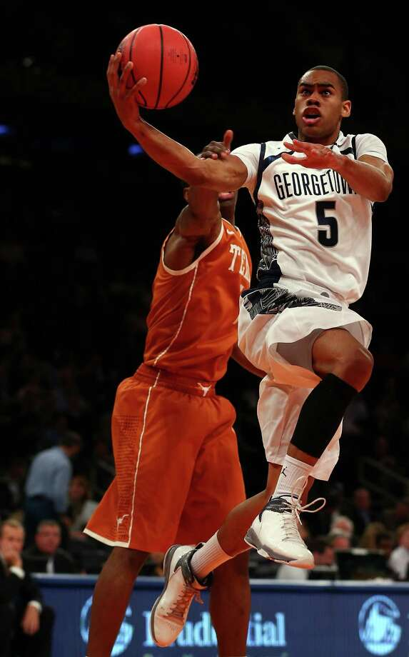 Markel Starks #5 of the Georgetown Hoyas takes a shot as Sheldon McClellan #1 of the Texas Longhorns defends during the Jimmy V Classic on December 4, 2012 at Madison Square Garden in New York City. Photo: Elsa, Getty Images / 2012 Getty Images