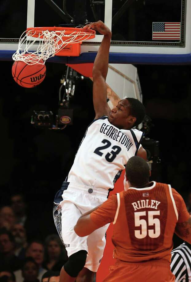Aaron Bowen #23 of the Georgetown Hoyas dunks the ball over Cameron Ridley #55 of the Texas Longhorns during the Jimmy V Classic on December 4, 2012 at Madison Square Garden in New York City. The Georgetown Hoyas defeated the Texas Longhorns 64-41. Photo: Elsa, Getty Images / 2012 Getty Images