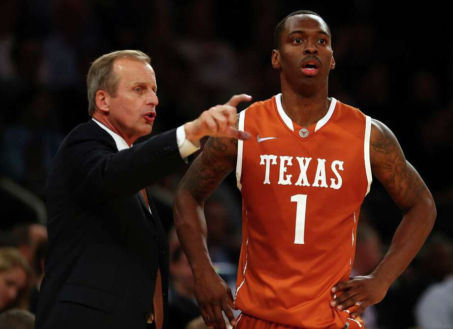 UT coach Rick Barnes and guard Sheldon McClellan (1) haven't seen eye to eye at times this season. Photo: Elsa, Getty Images / 2012 Getty Images