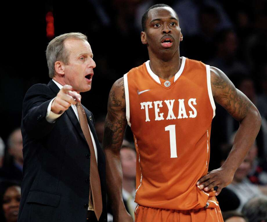 Texas head coach Rick Barnes talks to Sheldon McClellan (1) during the second half of their NCAA college basketball game against Georgetown in the Jimmy V Classic at Madison Square Garden, Tuesday, Dec. 4, 2012, in New York. Georgetown won 64-41. Photo: Frank Franklin II, Associated Press / AP